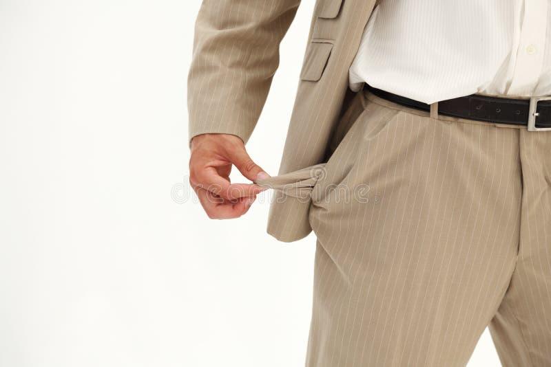 Geschäftsmann, der seine leere Tasche auszieht lizenzfreie stockfotografie