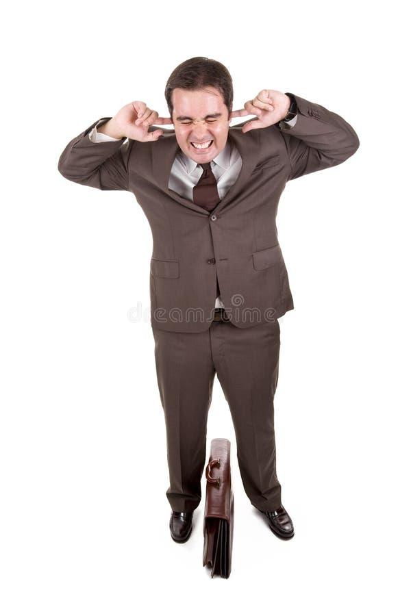 Geschäftsmann, der seine Ohren abdeckt stockfoto