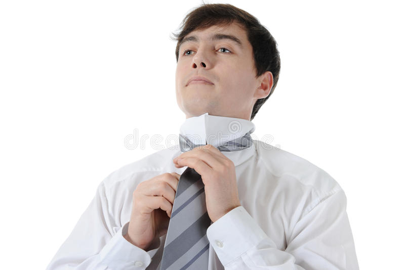 Geschäftsmann, der seins Gleichheit bindet stockfotos