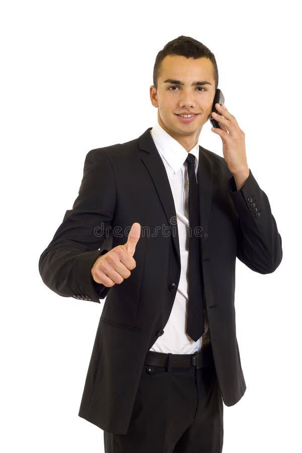 Geschäftsmann, der sich Daumen zeigt stockbilder
