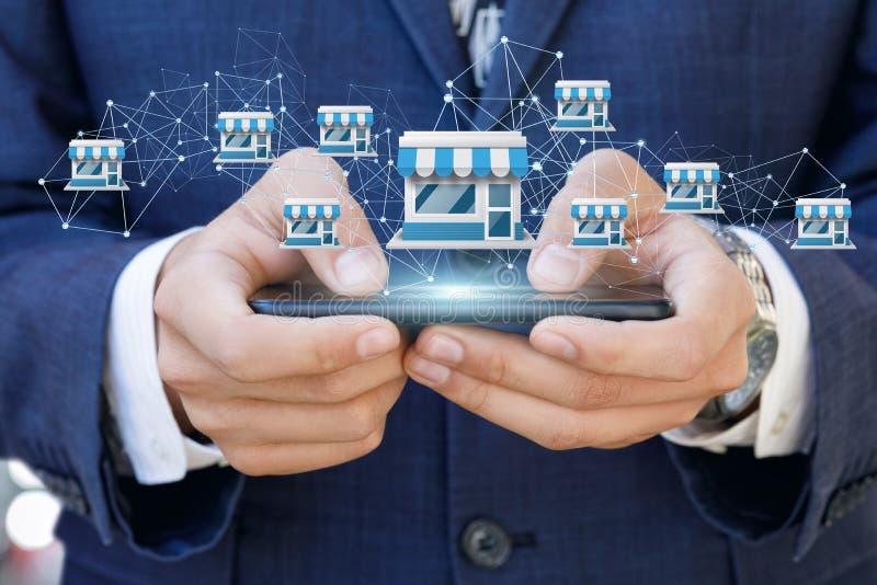 Geschäftsmann, der Vorrechtsystem auf einem Mobile zeigt lizenzfreies stockfoto