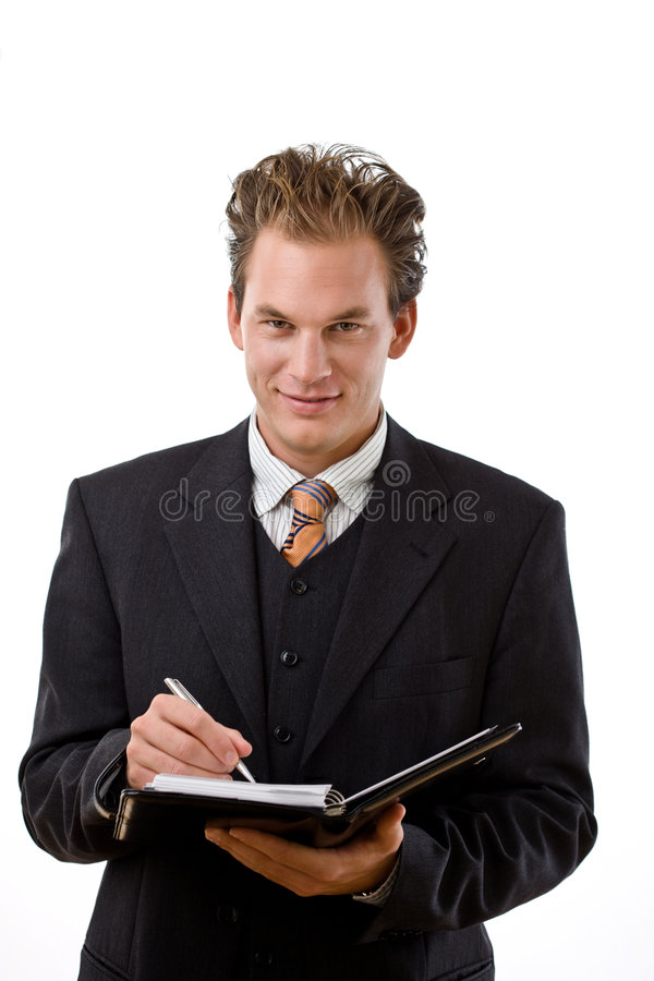 Geschäftsmann, der zum Notizbuch schreibt stockfotos