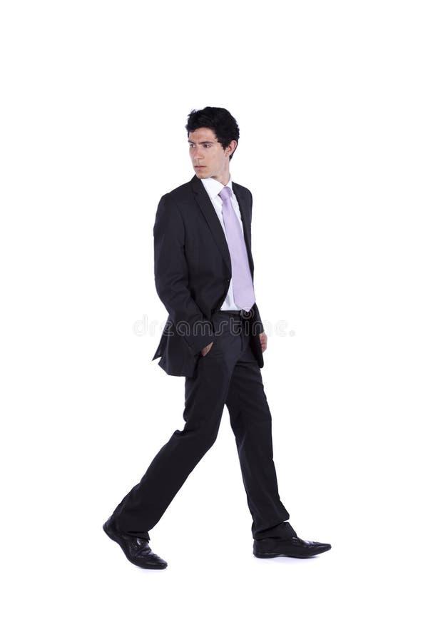 Geschäftsmann, der zurück geht und schaut lizenzfreies stockbild