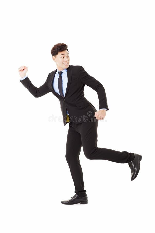 Geschäftsmann, der zurück läuft und schaut lizenzfreie stockbilder