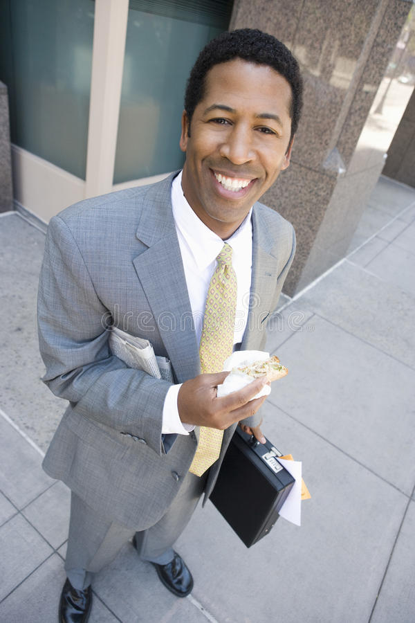 Geschäftsmann Eating Sandwich stockfoto