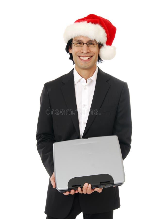 Geschäftsmann in einem Sankt-Hut lizenzfreies stockfoto