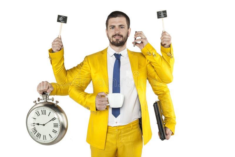 Geschäftsmann in einer goldenen Klage ist sehr Vielzweck lizenzfreies stockbild