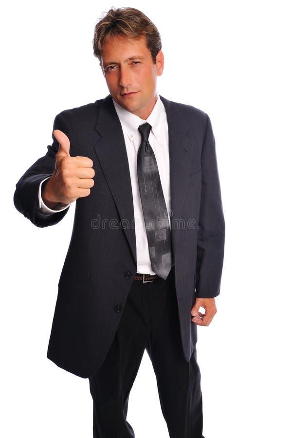 Geschäftsmann gibt Daumen auf lizenzfreies stockfoto