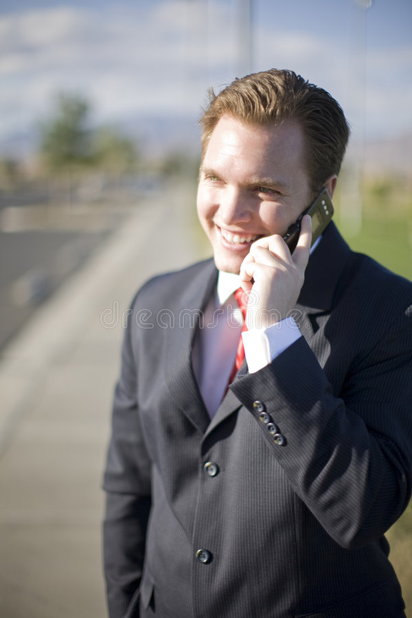 Geschäftsmann-Handy lizenzfreie stockfotos