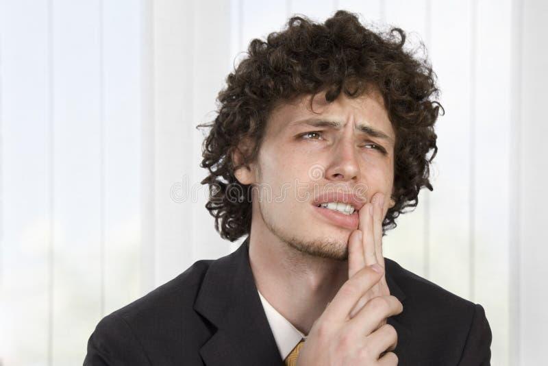 Geschäftsmann hat Zahnschmerzen stockfoto