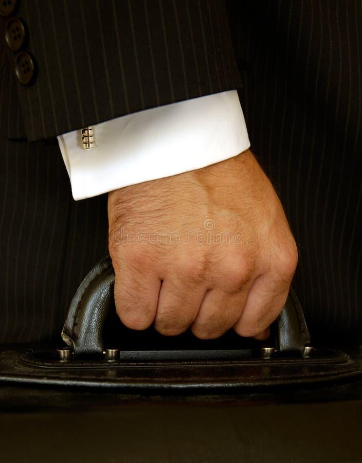 Geschäftsmann-Holding-Fall lizenzfreie stockbilder