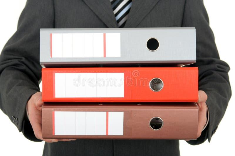 Geschäftsmann-Holding-Mappen stockfotografie