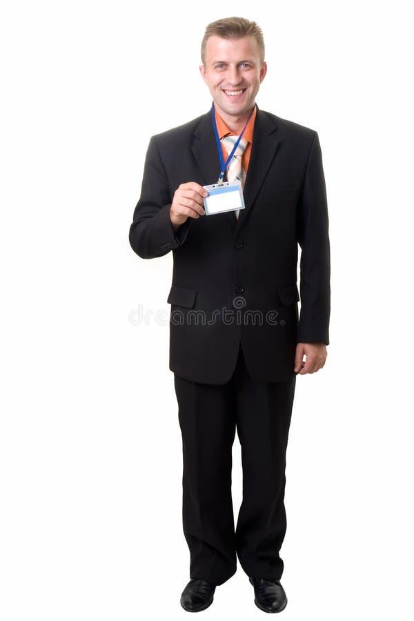 Geschäftsmann mit Abzeichen lizenzfreie stockfotografie