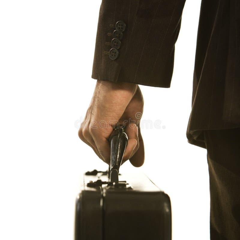 Geschäftsmann mit Aktenkoffer. lizenzfreies stockbild