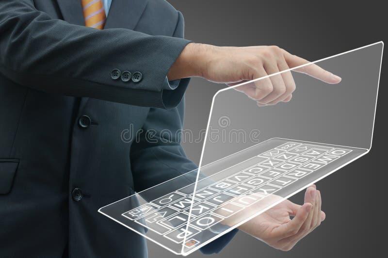 Geschäftsmann mit Computer lizenzfreie stockbilder