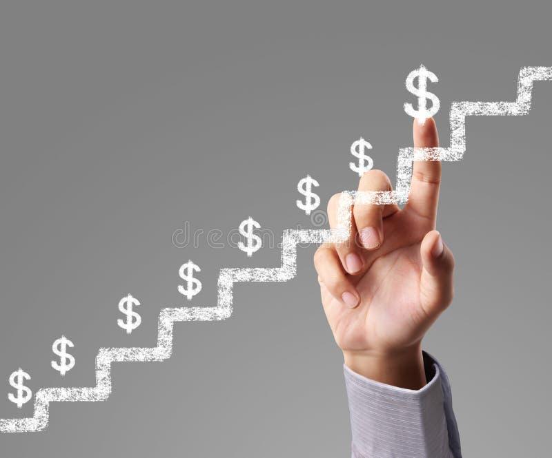 Geschäftsmann mit den Finanzsymbolen, die von der Hand kommen lizenzfreie stockfotos