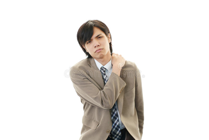 Geschäftsmann mit den Schulterschmerz. stockfoto