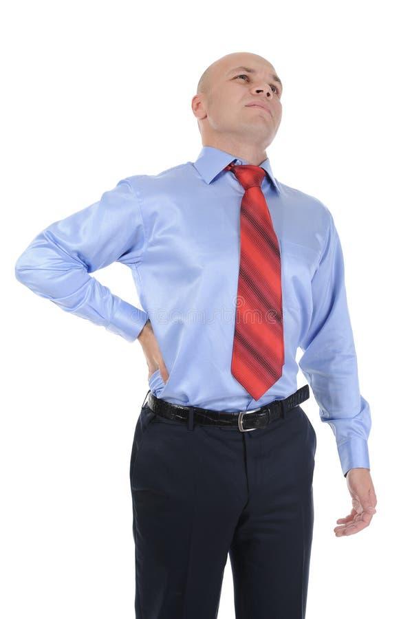 Geschäftsmann mit den starken rückseitigen Schmerz stockfotografie