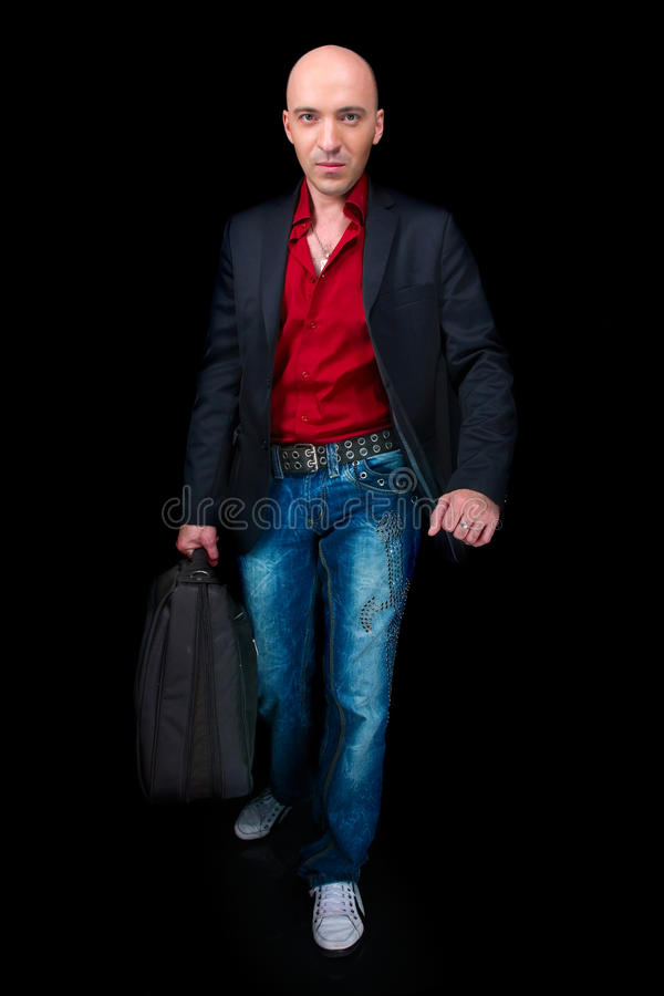 Geschäftsmann mit einem Koffer lizenzfreie stockbilder