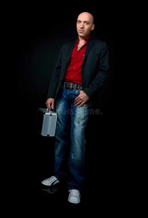 Geschäftsmann mit einem Koffer stockbilder