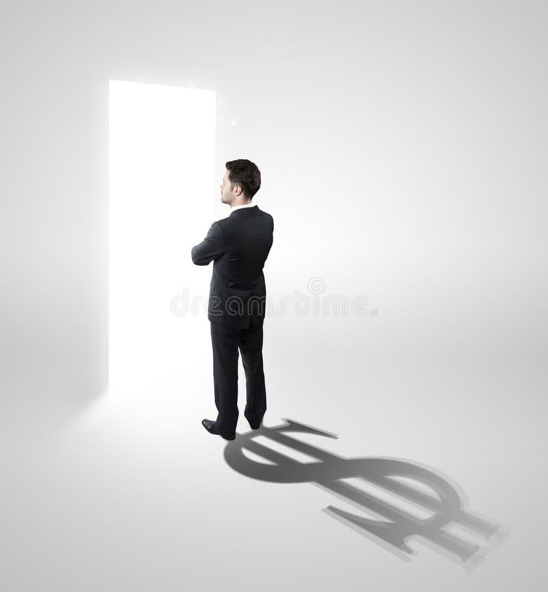 Geschäftsmann mit einem Schatten, der als Bargeld geformt wird, singen stockfoto