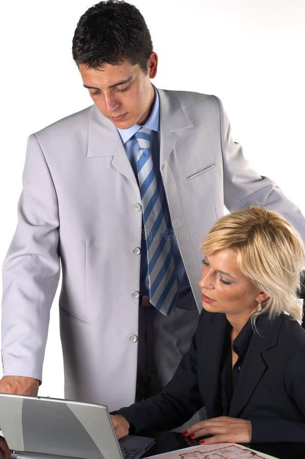 Geschäftsmann mit einem Sekretär stockfotos