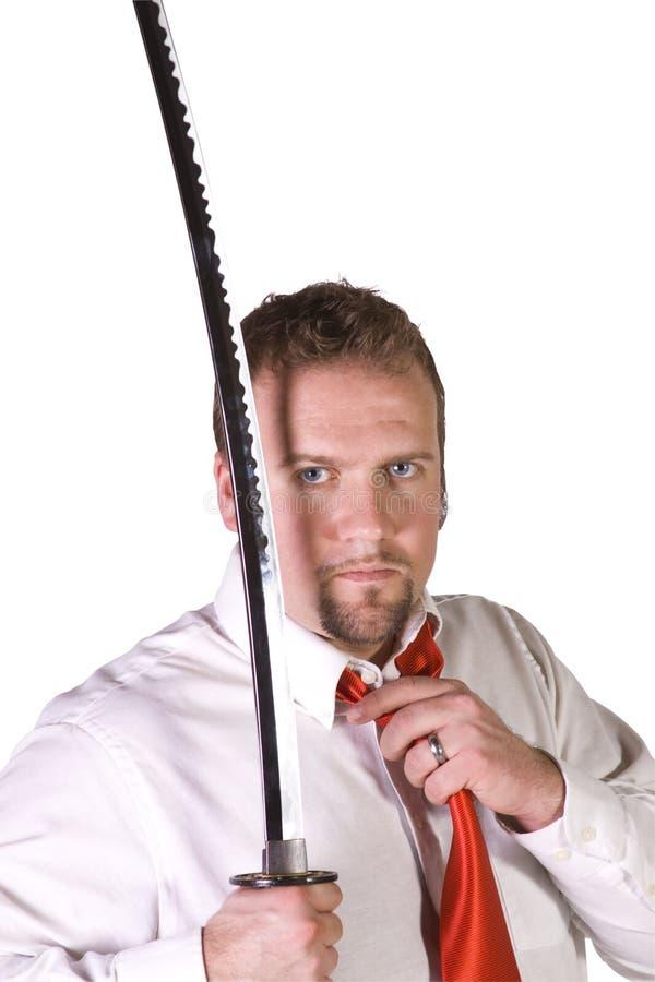 Geschäftsmann mit einer Klinge stockfoto