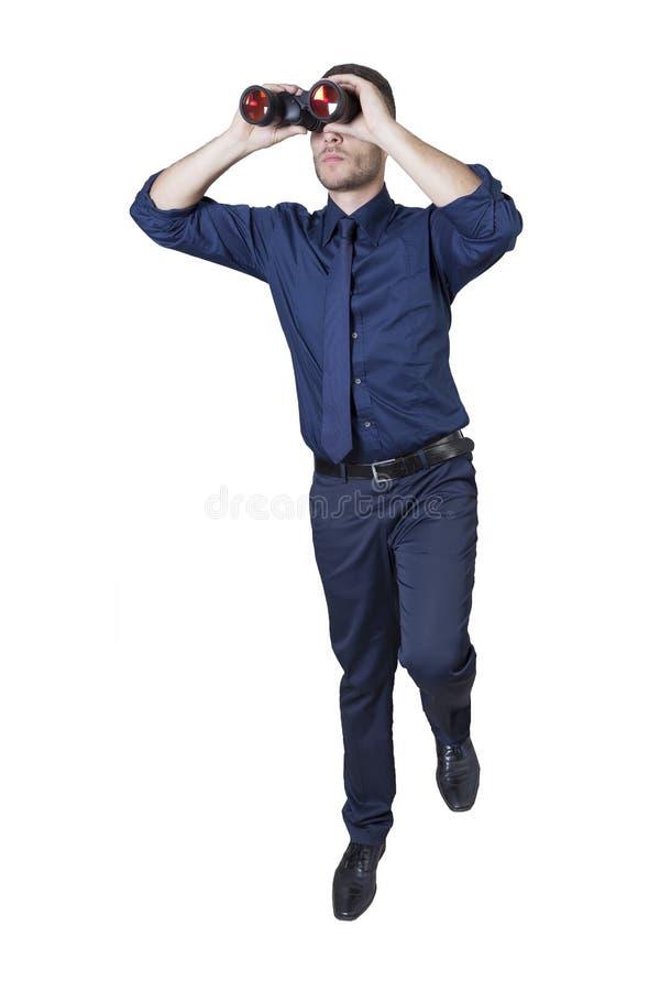 Geschäftsmann mit Ferngläsern auf einer Leiter lizenzfreies stockfoto