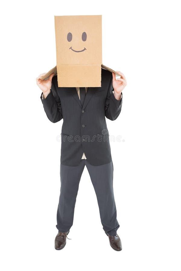 Geschäftsmann mit Kasten auf Kopf stockbild