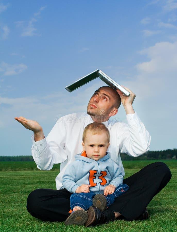 Geschäftsmann mit Kleinkind stockbilder
