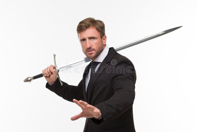Geschäftsmann mit Klinge lizenzfreie stockfotografie