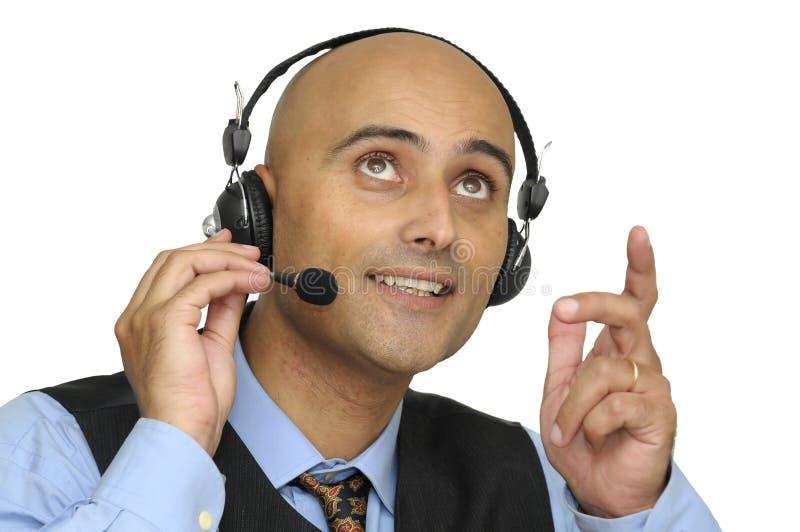 Geschäftsmann mit Kopfhörer lizenzfreie stockbilder
