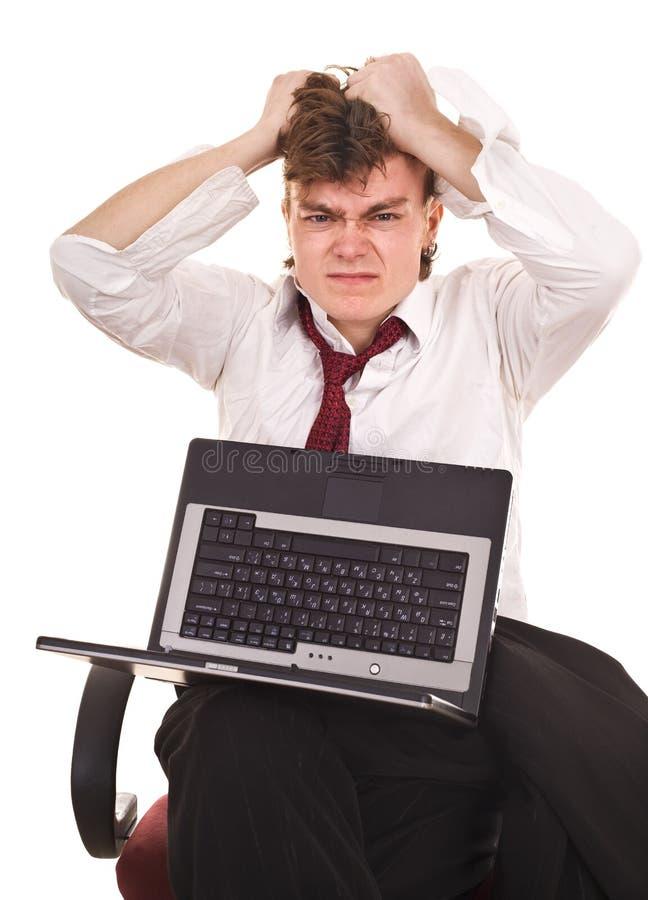 Geschäftsmann mit Laptop in der Krise. lizenzfreies stockbild