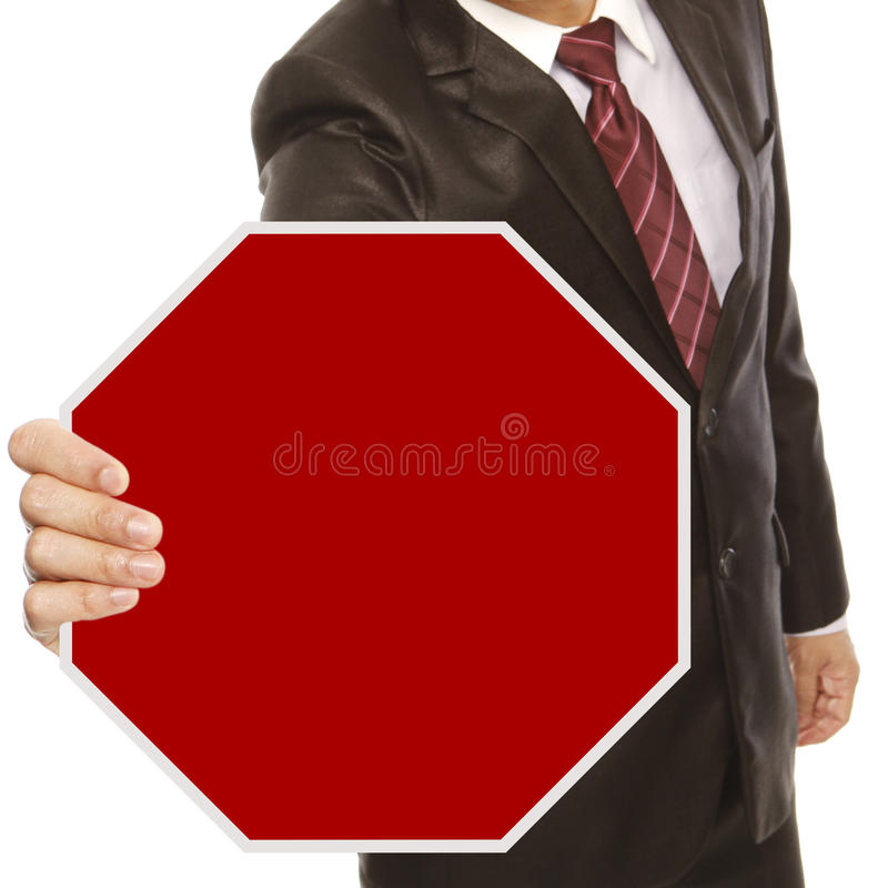 Geschäftsmann mit leerem Stoppschild stockbild