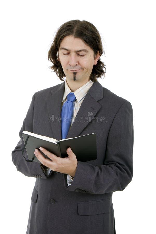Geschäftsmann mit Notizbuch lizenzfreie stockbilder