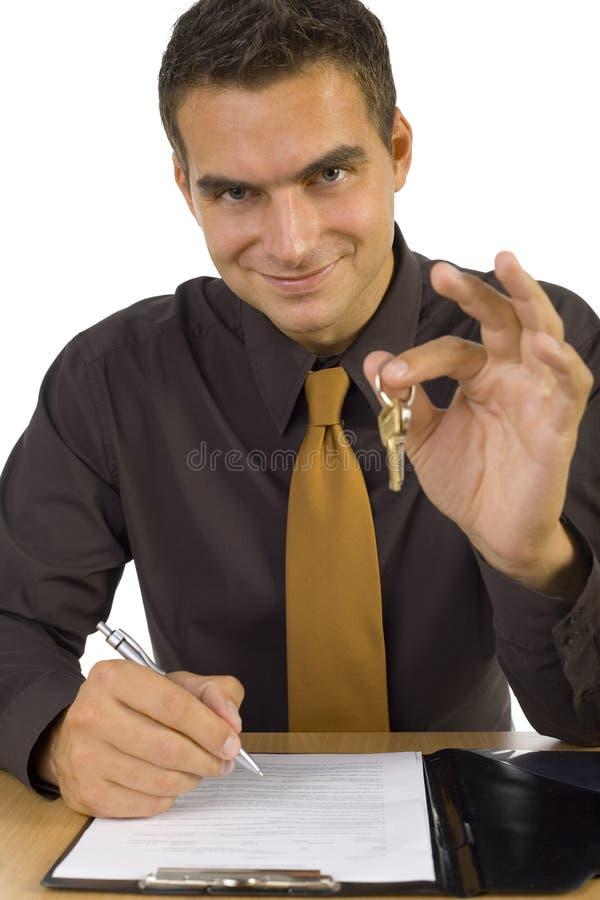 Geschäftsmann mit Tasten stockbild