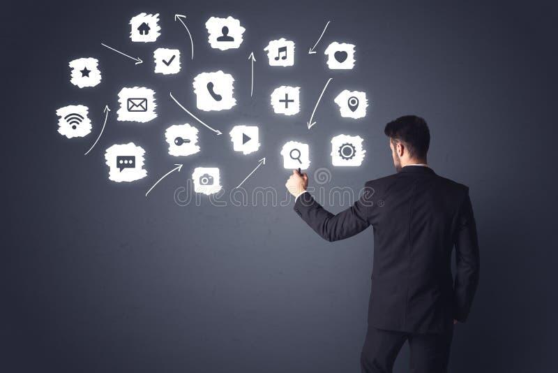 Geschäftsmann mit weißen Anwendungen stockbilder