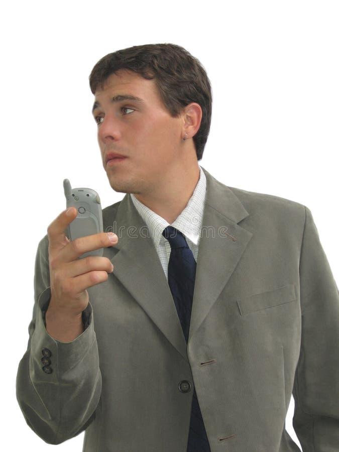 Geschäftsmann mit Zelle lizenzfreie stockbilder