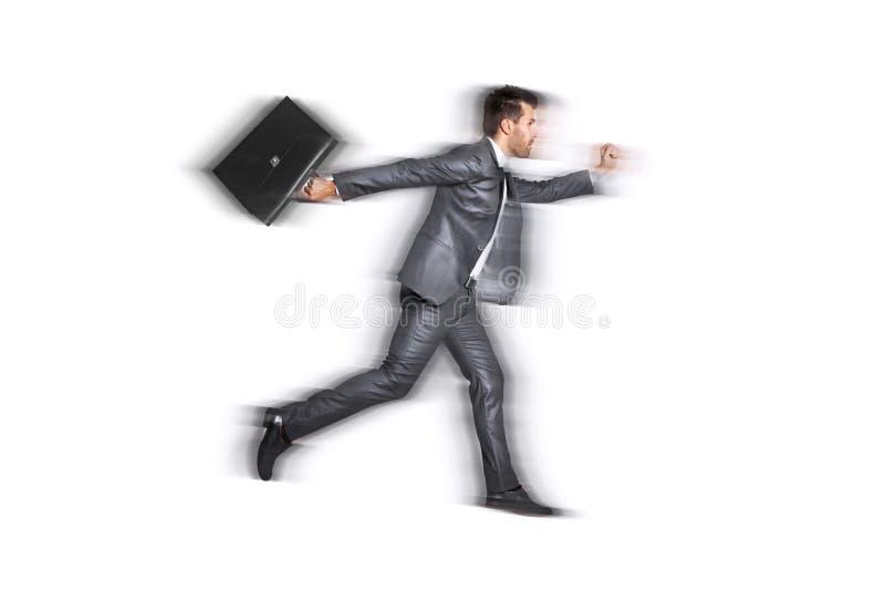 Geschäftsmann sehr, der schnell für Arbeit läuft lizenzfreies stockfoto