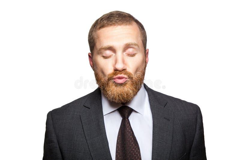 Geschäftsmann senden Kuss mit clossed Augen stockbilder