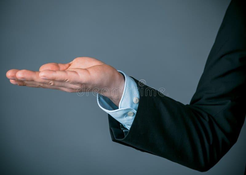 Geschäftsmann Showing Something mit Kopien-Raum stockbilder