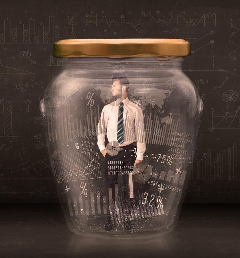 Geschäftsmann traped im Glas mit Diagrammdiagramm-Symbolkonzept lizenzfreies stockbild