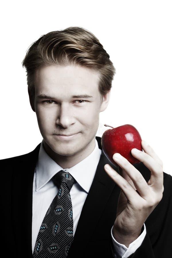 Geschäftsmann und Apfel lizenzfreie stockbilder