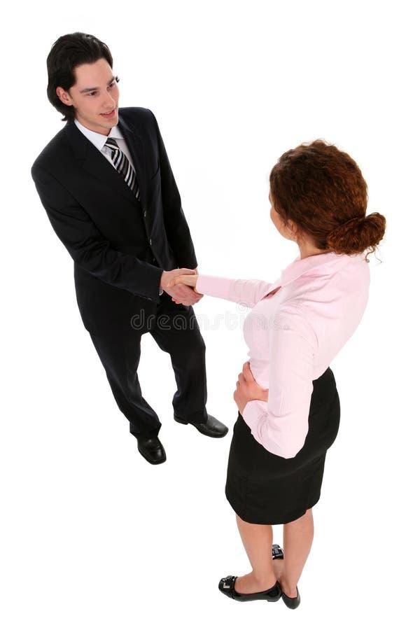 Geschäftsmann und Frau, die Hände rütteln lizenzfreie stockfotos