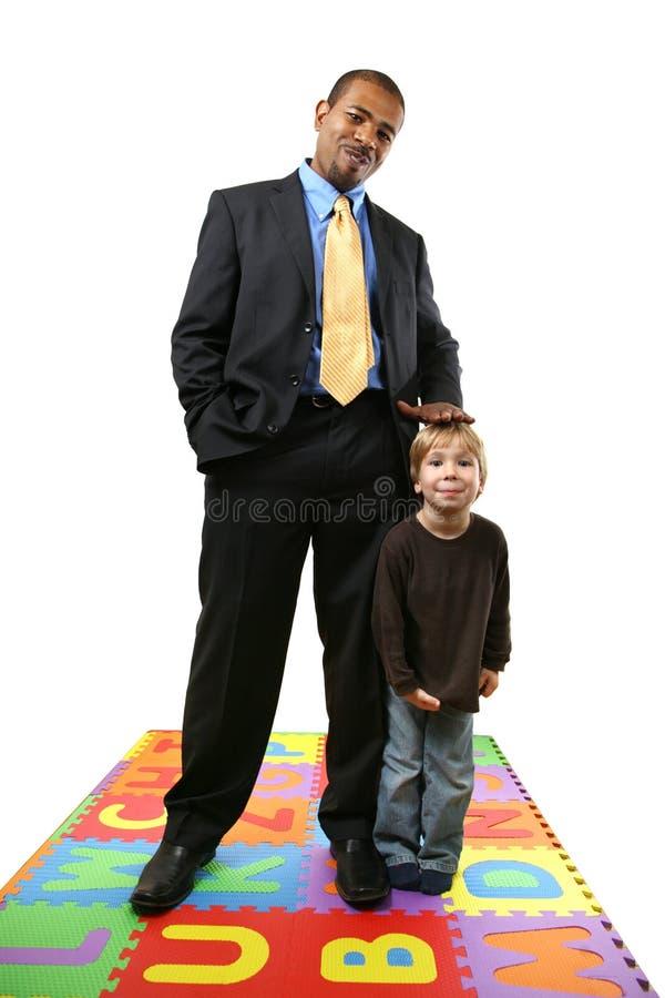 Geschäftsmann und Kind lizenzfreie stockfotografie