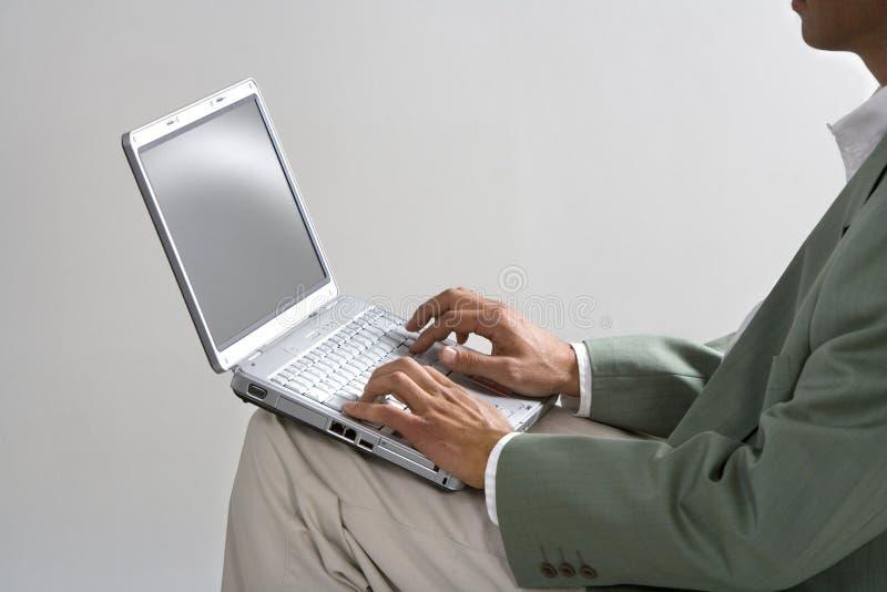 Geschäftsmann und Laptop stockbilder