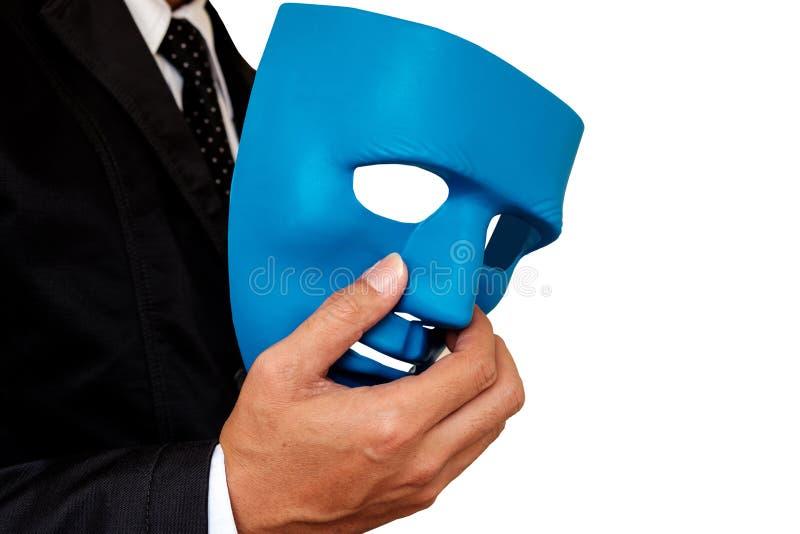 Geschäftsmann und Maske lizenzfreie stockbilder