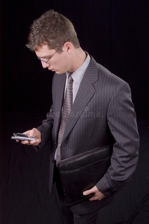 Geschäftsmann und PDA lizenzfreies stockbild