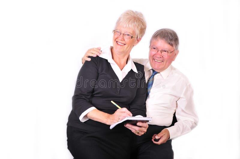Geschäftsmann und Sekretär Taking Notes stockfotografie