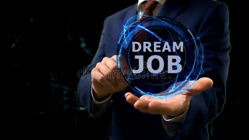Geschäftsmann zeigt Konzepthologramm Traumjob auf seiner Hand lizenzfreies stockfoto